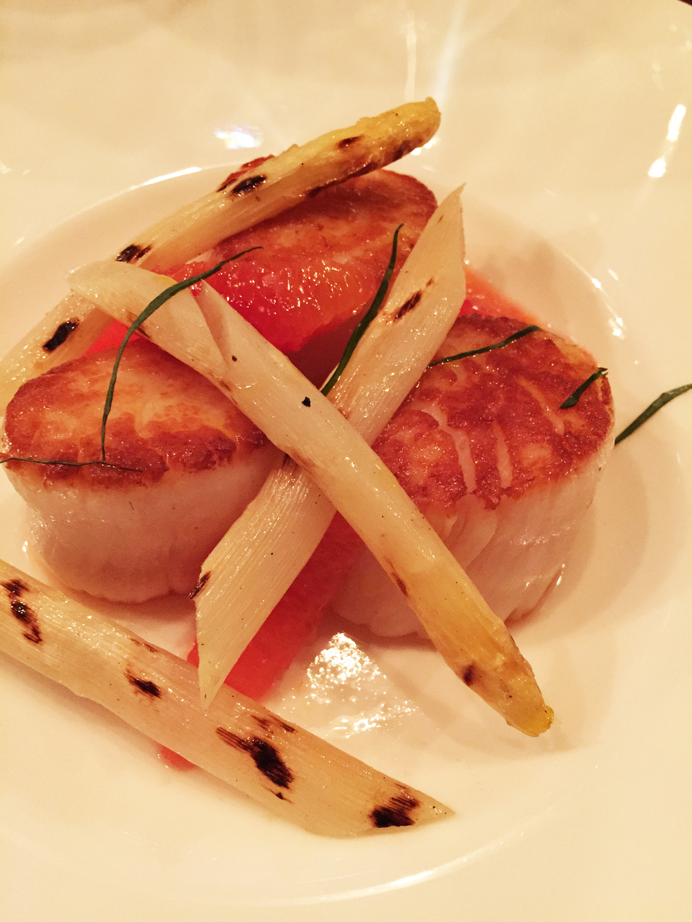Scallops with blood orange and white asparagus.