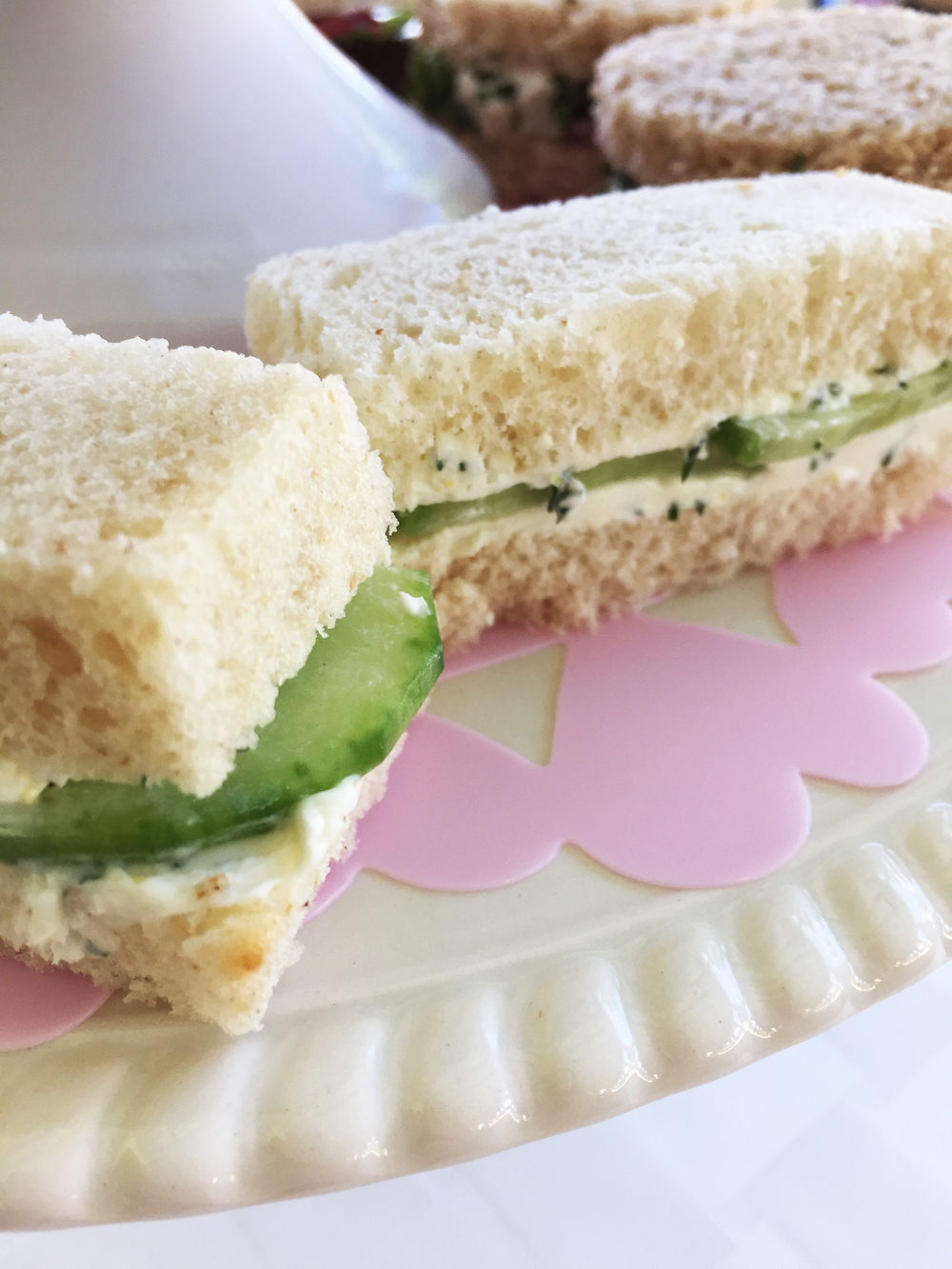 Thinly sliced cucumber with dill and cream cheese finger sandwiches.