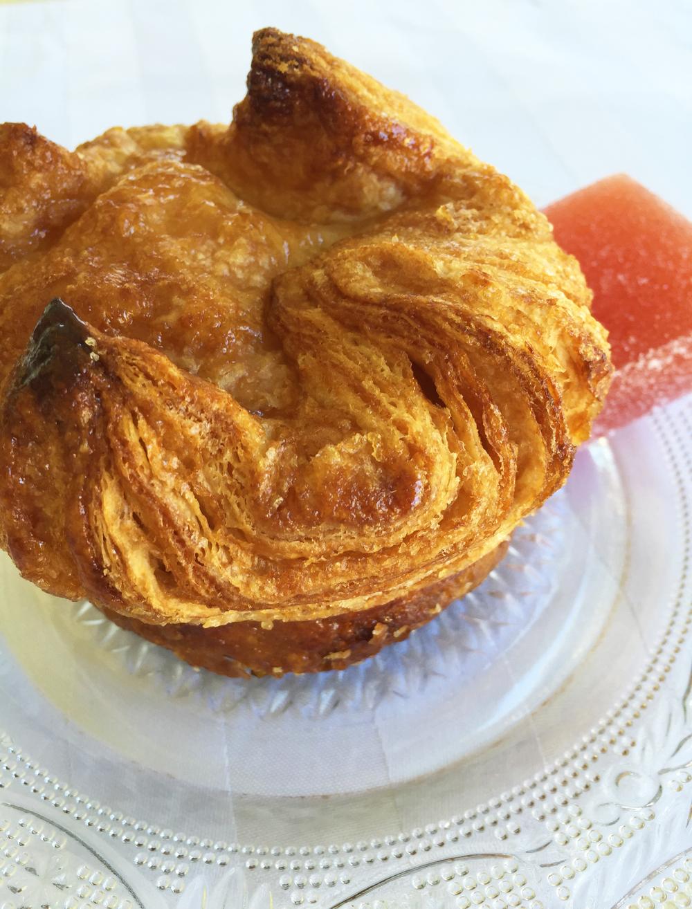 A perfect Kouign-amann, paired with a Blood Orange P  âte De Fruit.