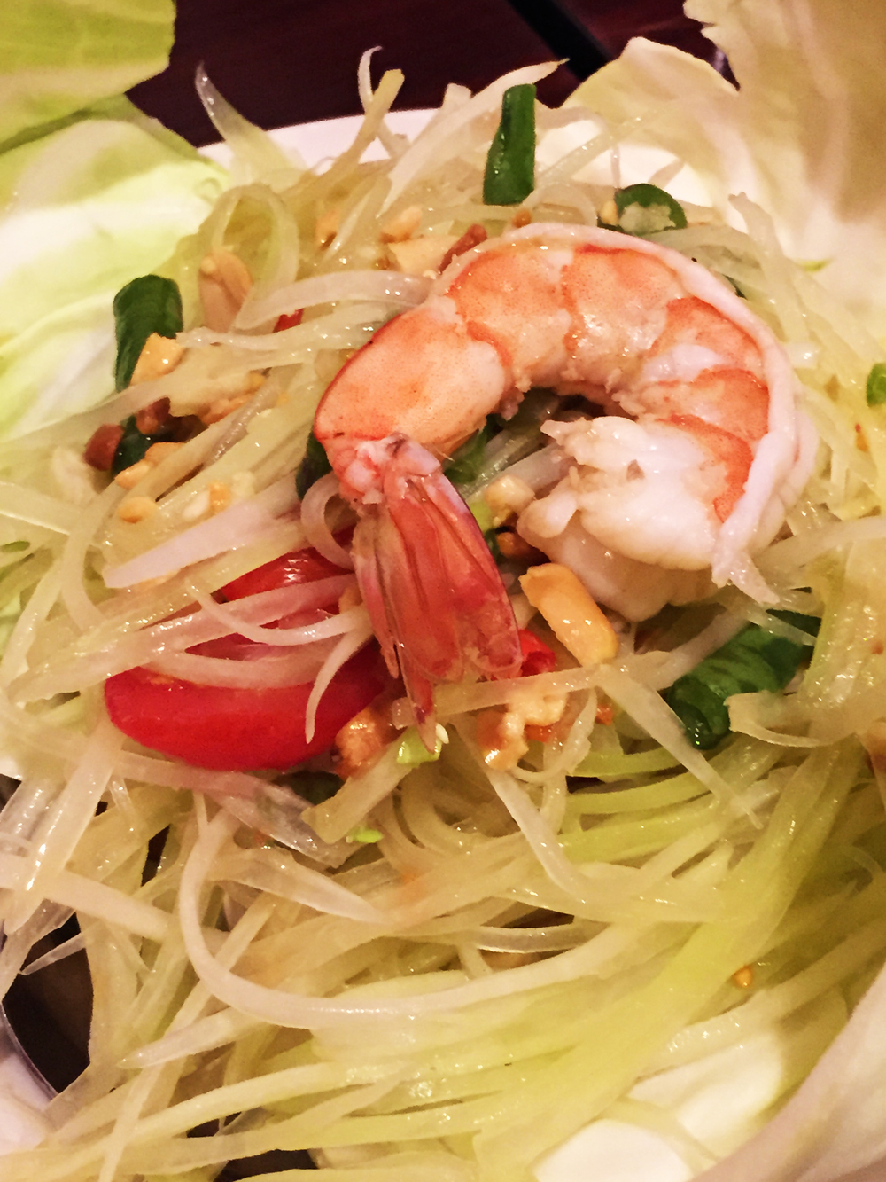 SOM TUM - PAPAYA SALAD - Julienne of green papaya with Thai Style flavor, mixed with garlic, Thai chilies, tomatoes, dried shrimp, ground peanuts and lime juice.