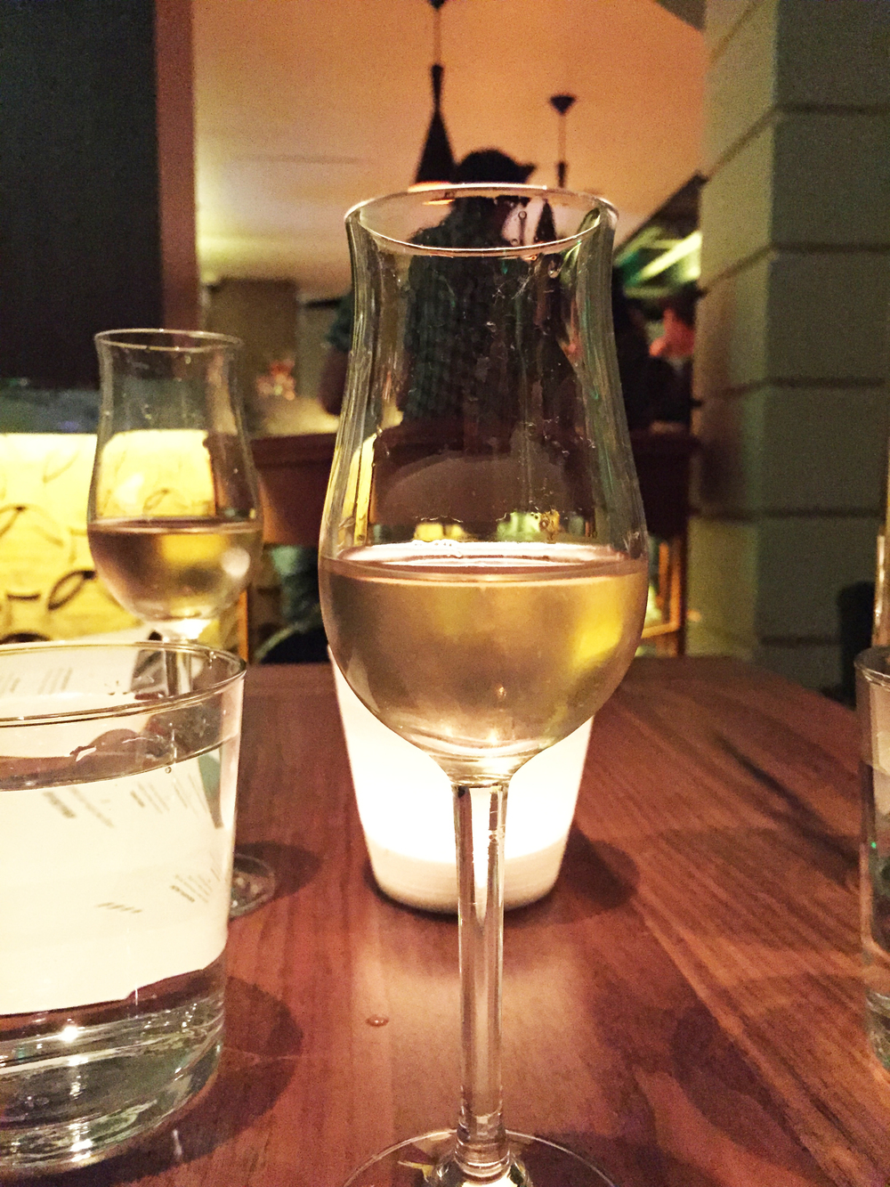 """""""Amuse Booze"""" aperitif with dry vermouth, clarified lemon, sherry, and simple syrup."""