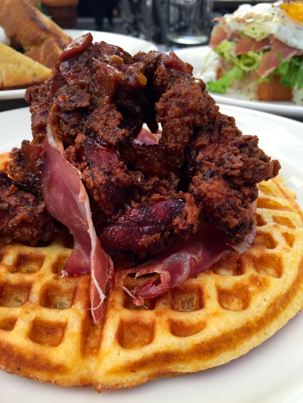 Spanish fried chicken & cornmeal waffle jamon butter & maple syrup.