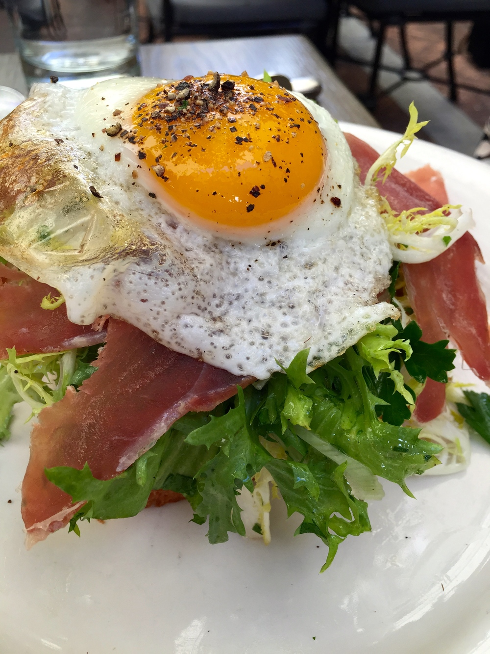 A.O.C. brioche with melted gruyère, frisée, prosciutto & sunny-side up egg.