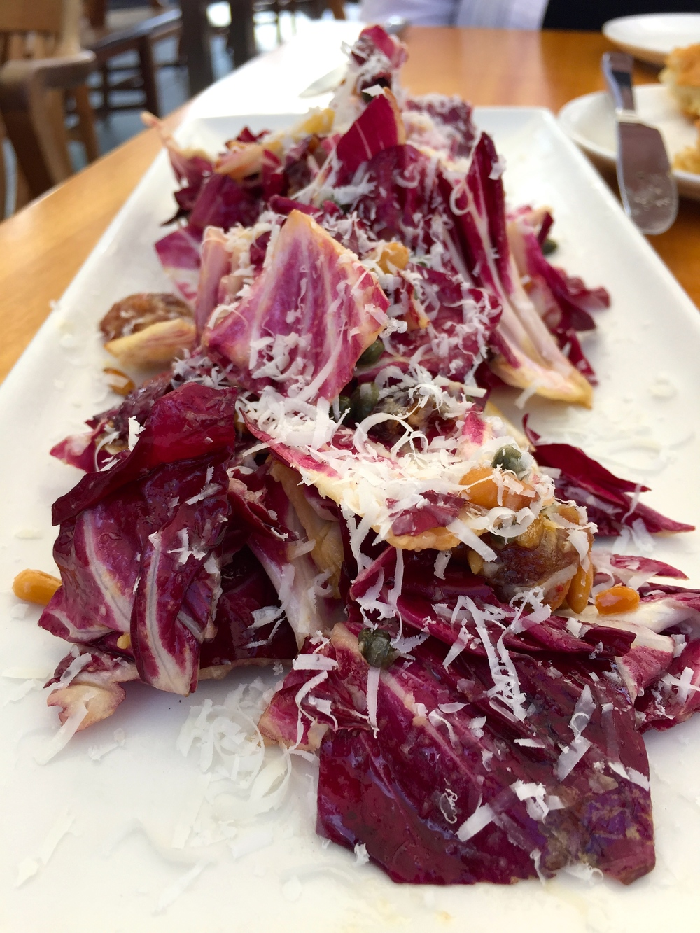 Verona Radicchio, honey dates, pine nuts, capers, bagna cauda, pecorino and sardo.
