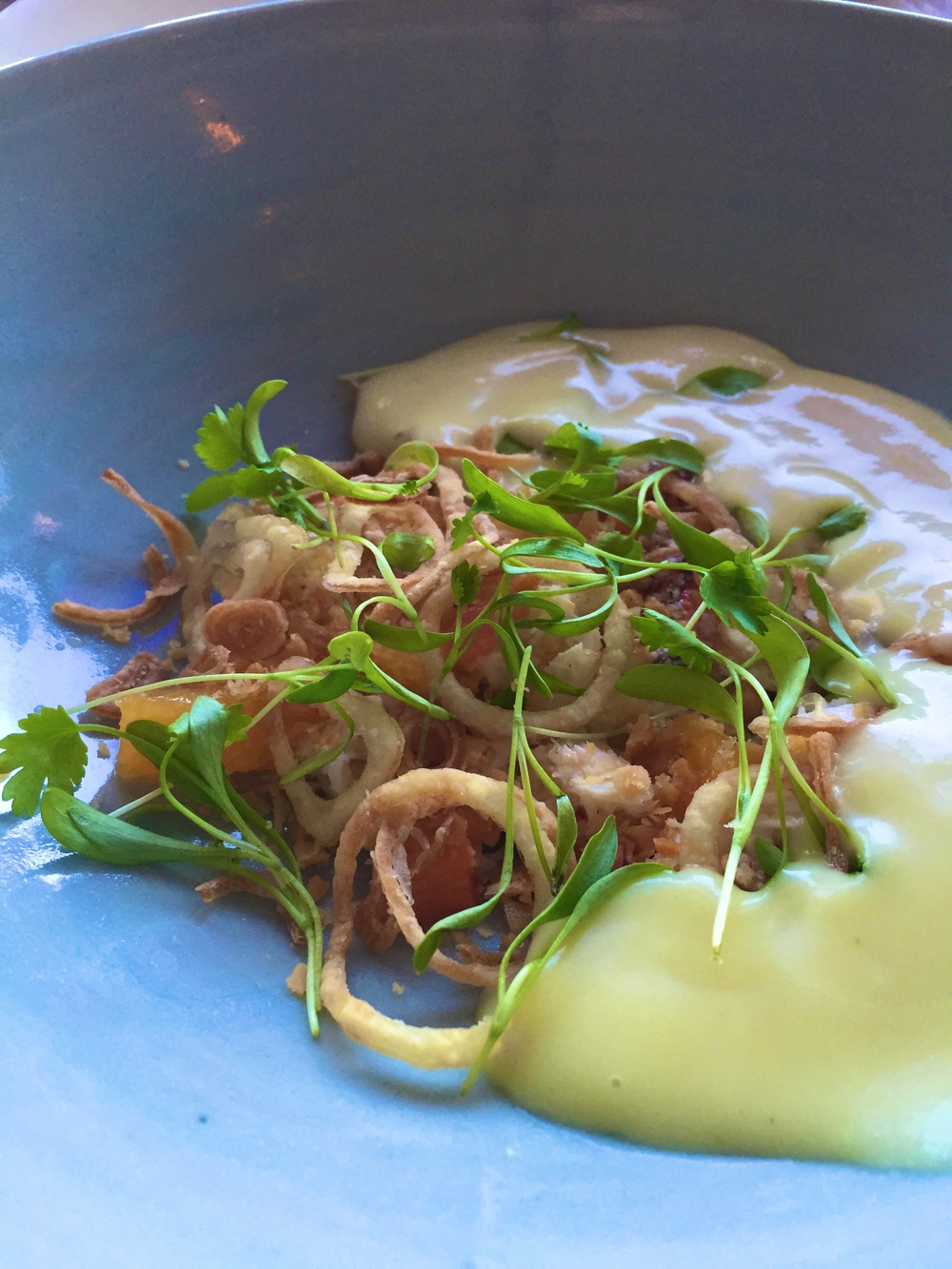 Dungeness crab & curry mojo citrus, white yam, crispy shallot, macadamia, and cilantro.