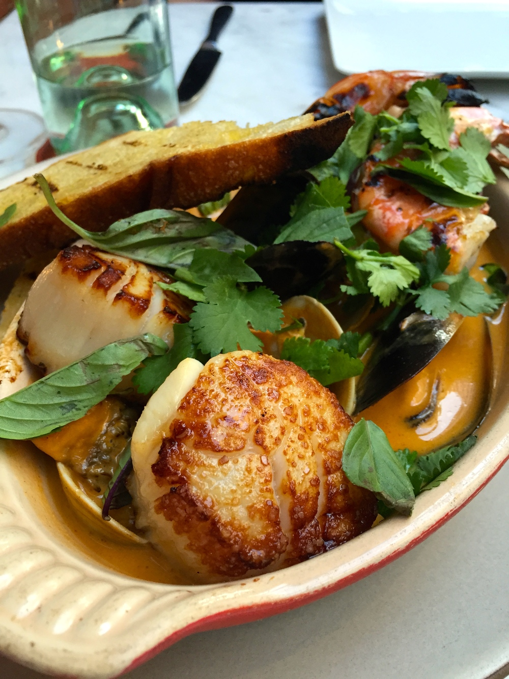 Shellfish pot with scallops, clams, mussels, shrimp, maitake mushrooms and curry.