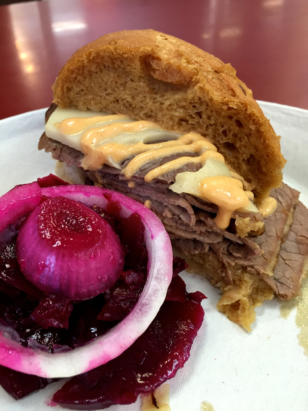 Beef Dip with Swiss cheese, Philippe's hot mustard, and pickled beet salad.