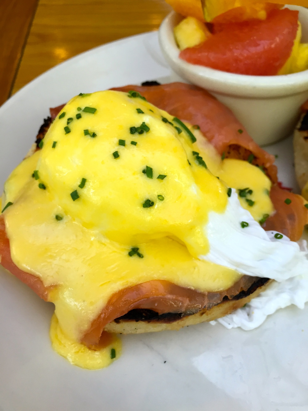 SMOKED SALMON BENEDICT poached eggs, hollandaise, english muffin, fruit.