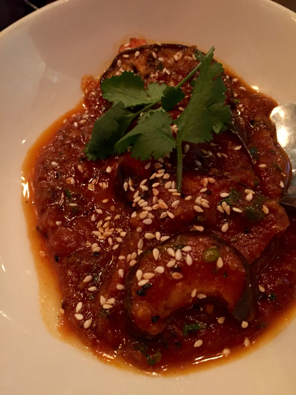 Eggplant Dish No. 3 - eggplant steaks with a tangy tomato & mustard seed sauce, finished with toasted sesame seeds.