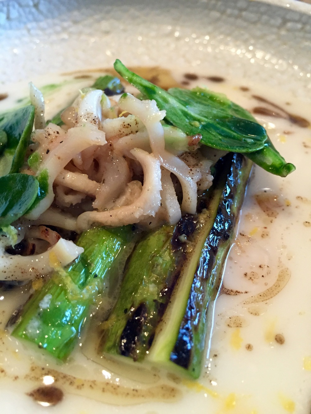 Charred California asparagus, parmesan broth, razor clams, and black pepper.