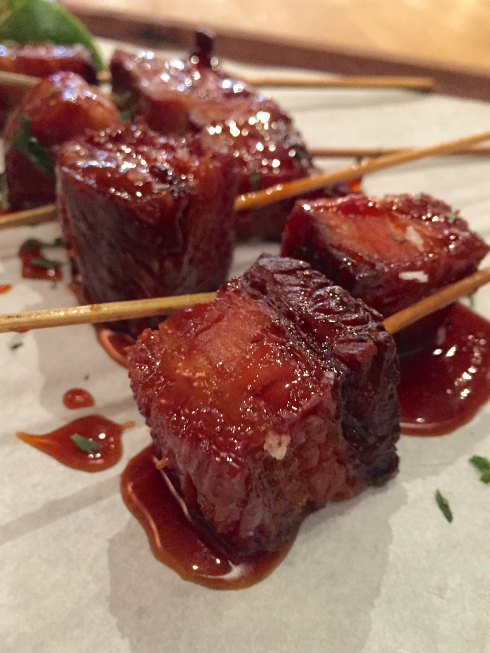 Pork Belly Skewers with maple glaze, lime, and cilantro.