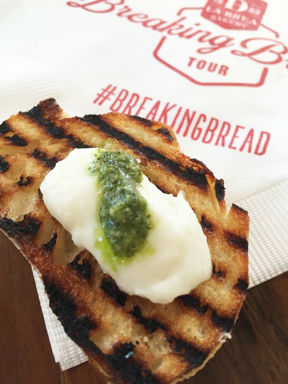 Grilled baguette with burrata and pesto.