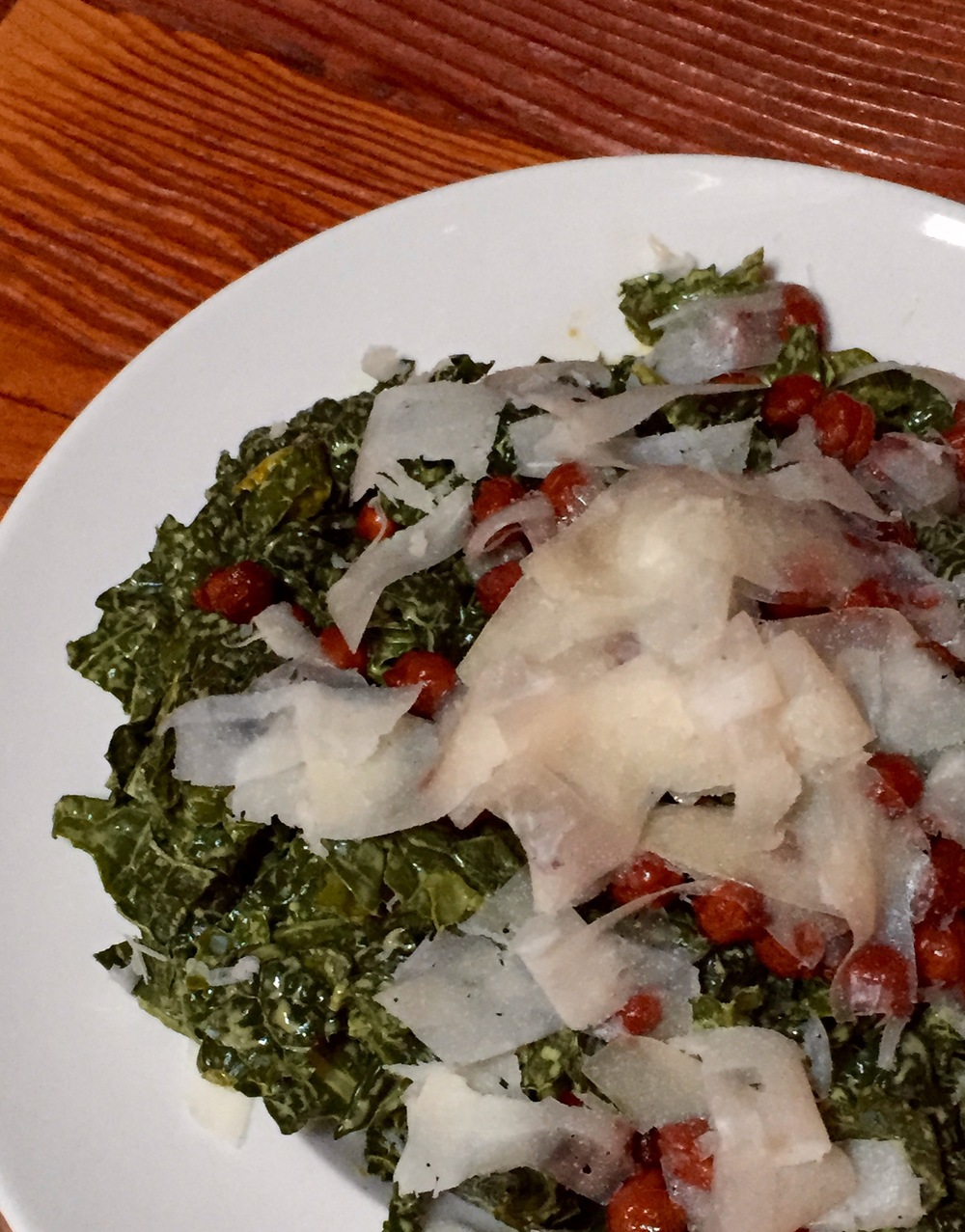Kale with green goddess dressing, manchego, castelvetrano olives, and fried chickpeas.