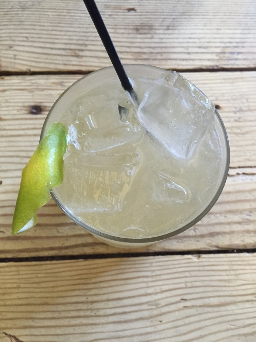 Margarita with blanco tequila, ancho reyes, dry curaco, salt tincture, and lime.