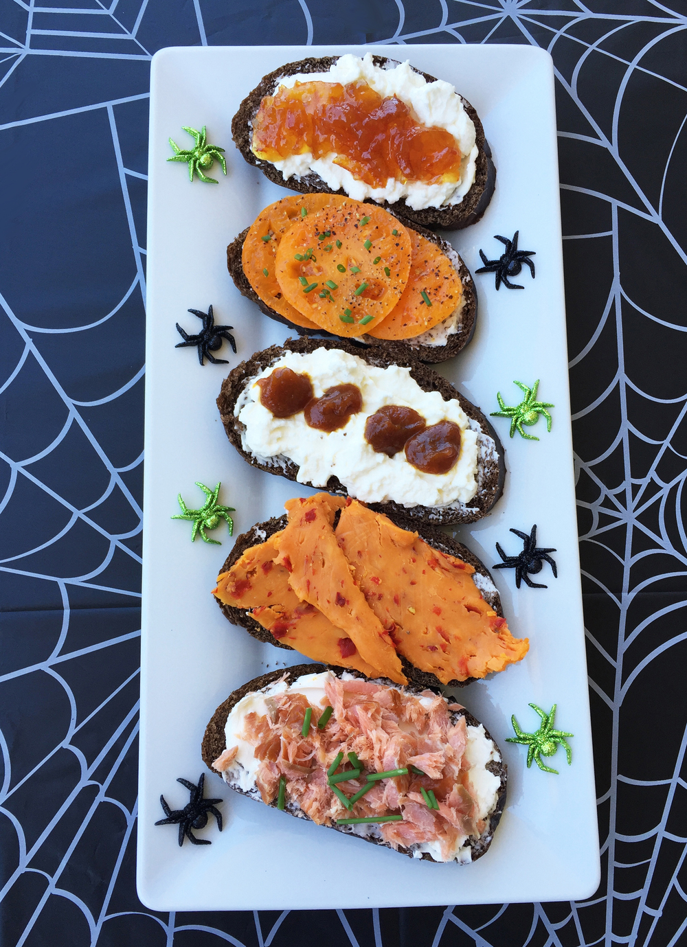 top to bottom : Ricotta and orange marmalade; Orange heirloom tomato slices with sweet butter and chives; Ricotta and pumpkin butter; Cheddar cheese with red jalapeno peppers; Flakes of hot smoked salmon with crème fraîche and chives