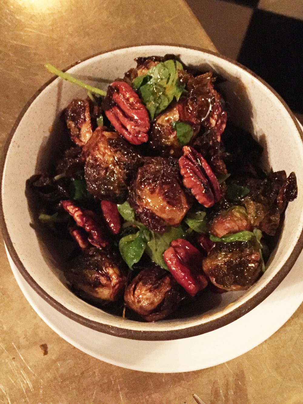 Sweet & spicy brussels sprouts with gram, pecans, and garlic confit.
