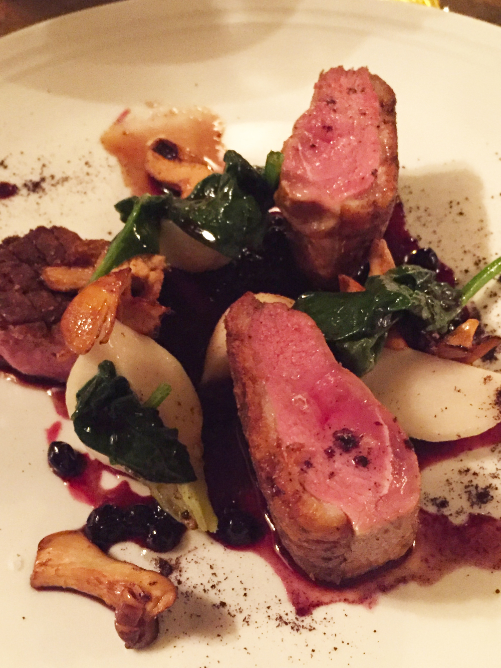 Liquorish Rubbed Duck Breast with Tokyo turnips, chanterelles, and huckleberry jus.