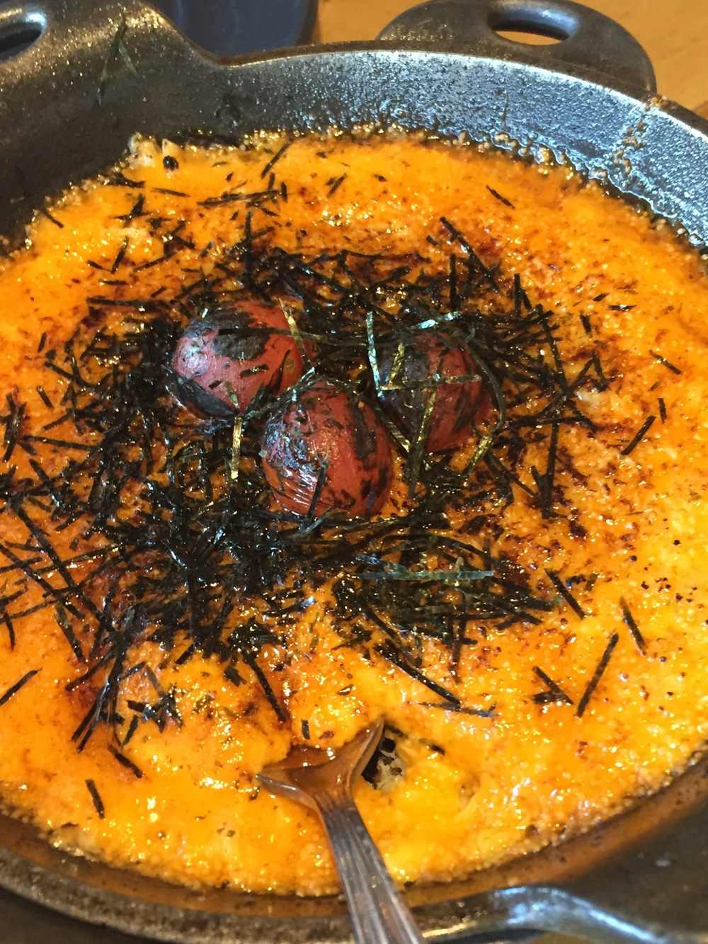 BAKED CRAB DIP - dynamite sauce, masago, charred tomato, nori, toast.