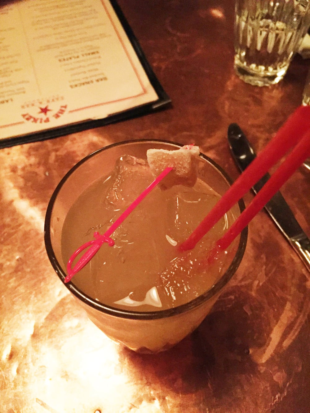GINGER MINGE -  Famous Grouse Scotch, Ginger Juice, Lemon Juice, Ginger Beer, Rocks.