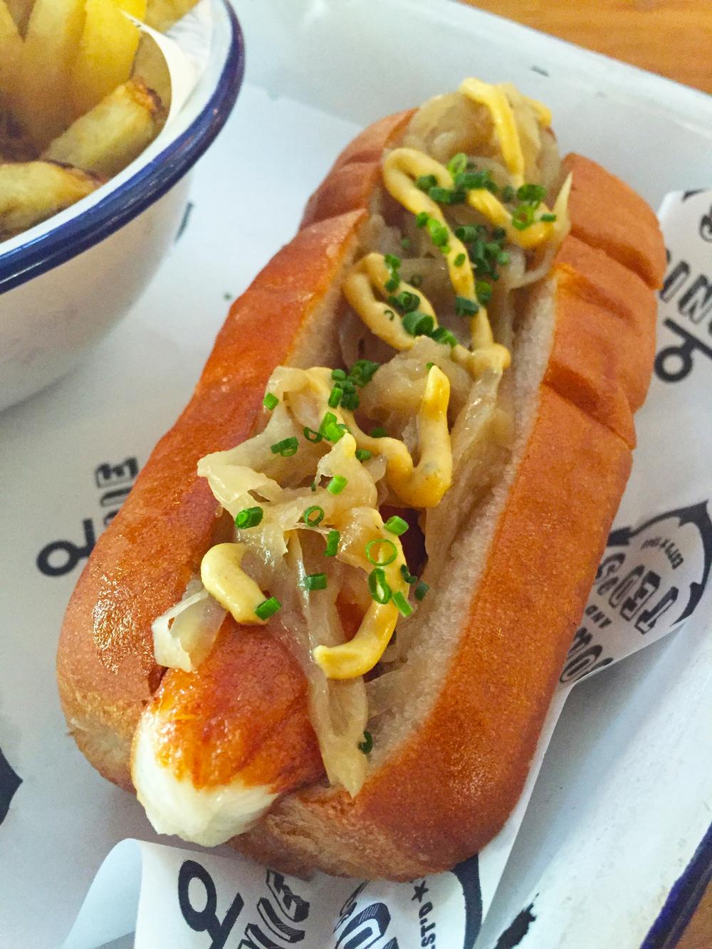 Hokkaido Dog with Hokkaido scallop sausage, onions, and smoked mustard