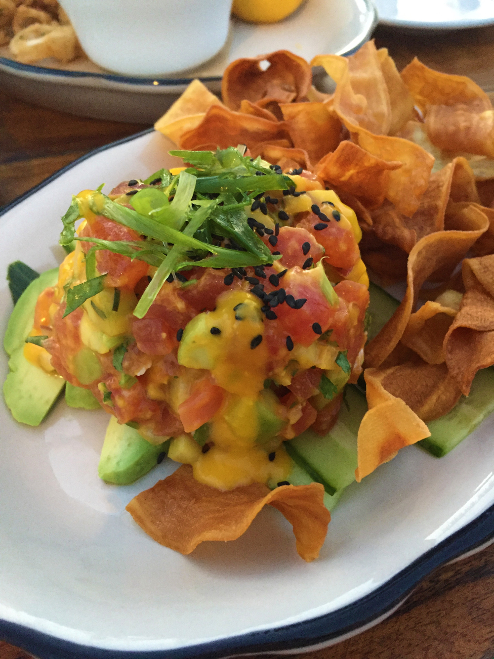 Tuna Tartare with ginger lime marinade, cilantro, avocado, and boniato chips.