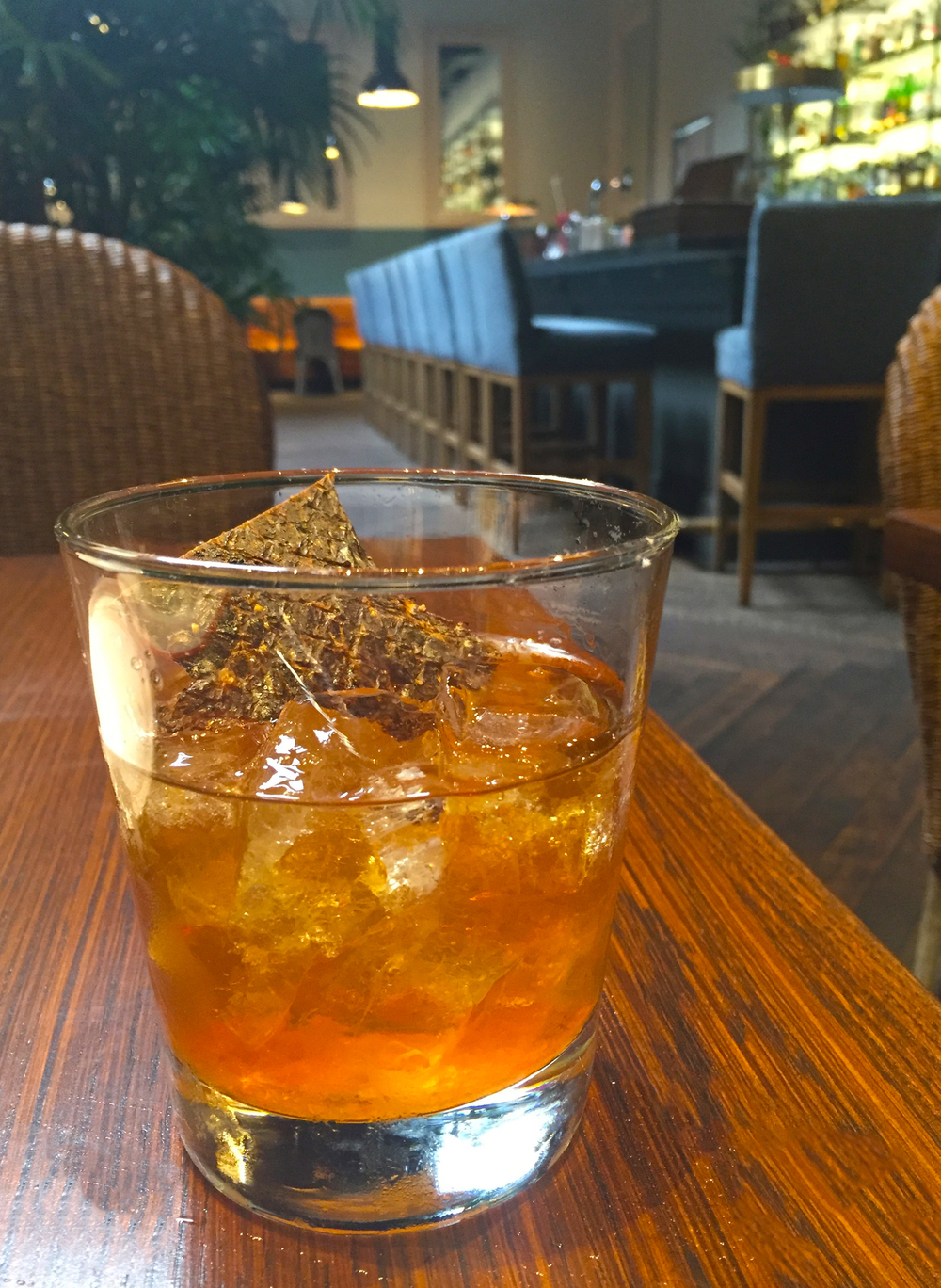 "BBQ Old Fashioned with Balcones ""Baby Blue"" bourbon, brown sugar, smoked BBQ bitters, and Belcampo Meat Co. beef jerky"