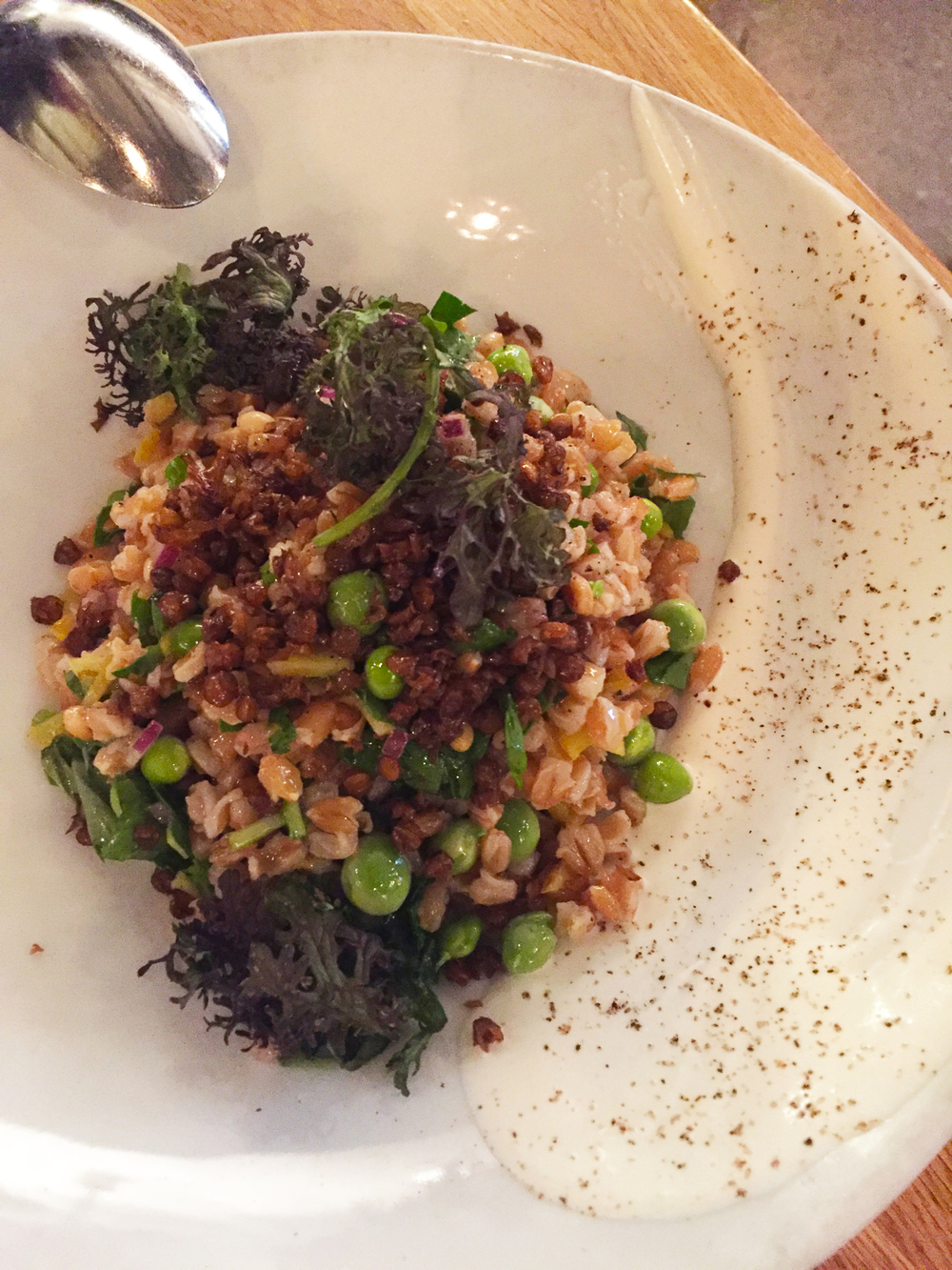 Farro Salad with crème fraîche, English peas, pine nuts, pickled sunchokes, fried lentils, and herbs.