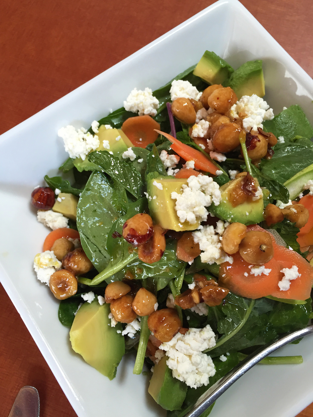 ASPARAGUS & MARKET BABY GREENS with hazelnut aillade, avocado, pickled carrots, feta, mint, lemon vinaigrette