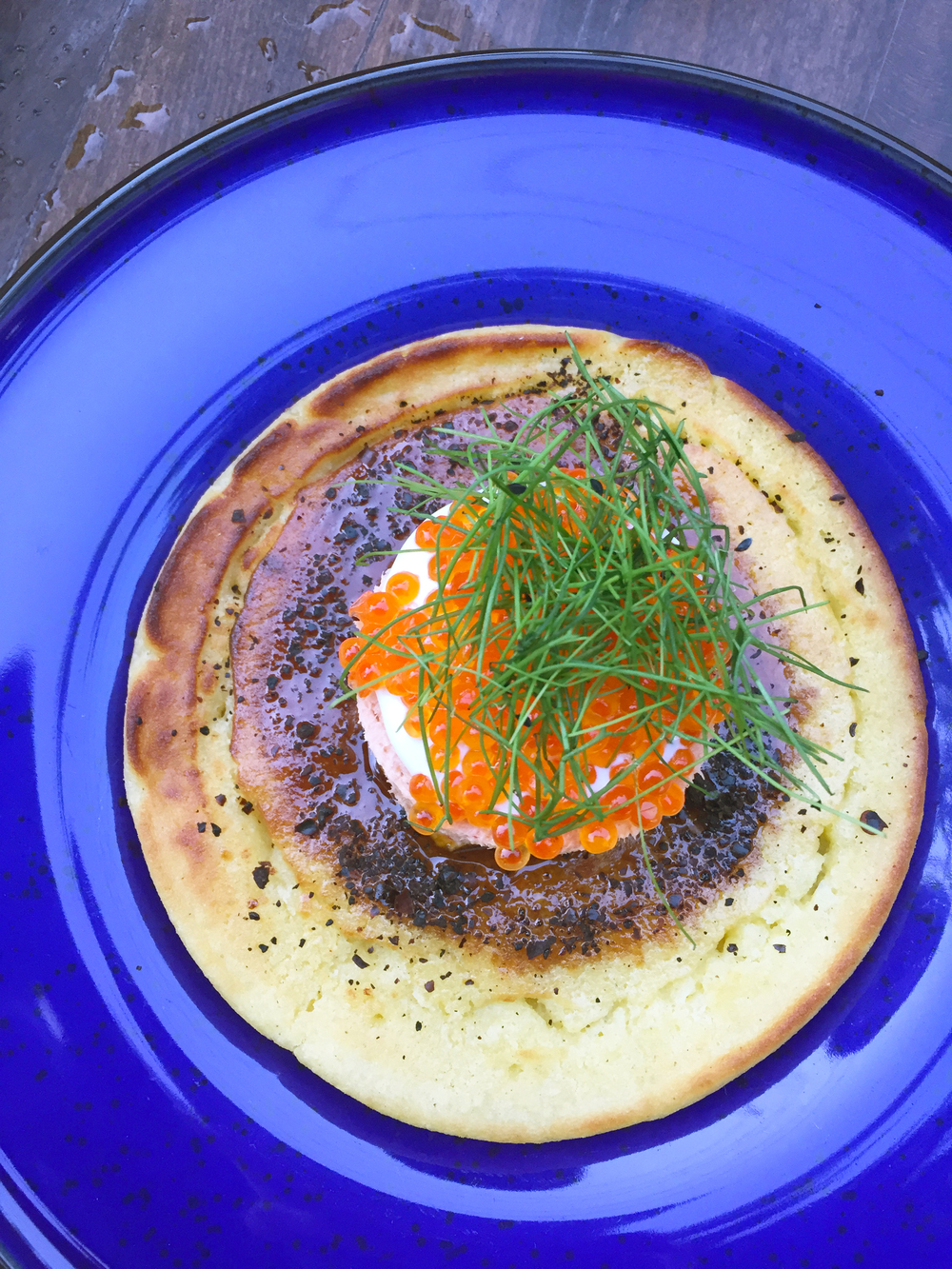 Smoked Arctic Char Rillettes with Trout Caviar, Hoecake, Meyer Lemon Crema, and Chives.