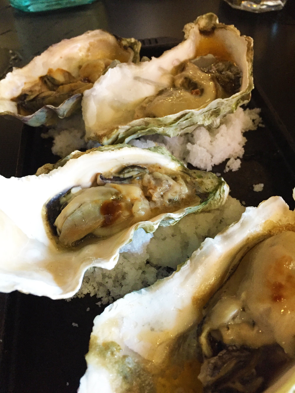 Grilled West Coast Oysters with Old Bay garlic butter.