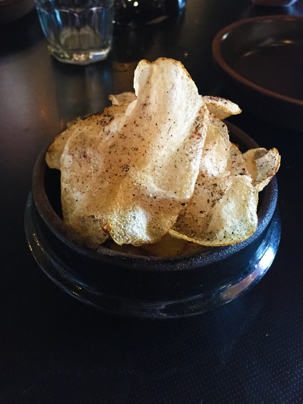 Potato Chips with pink peppercorn and burnt onion.