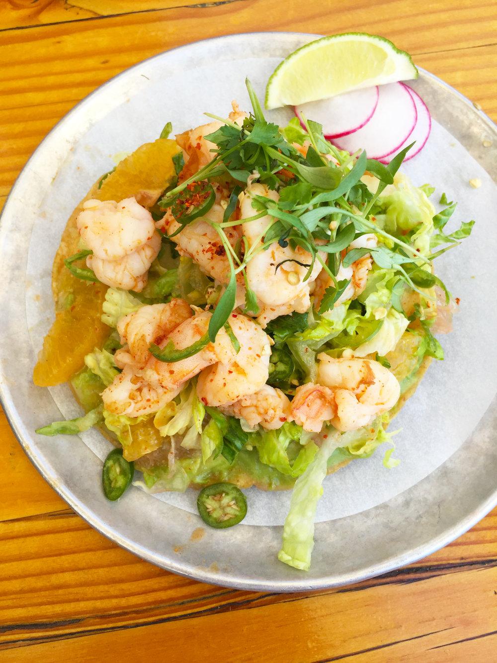 SHRIMP TOSTADA - citrus / lettuce / cherry tomato / hass avocado / serrano pepper.