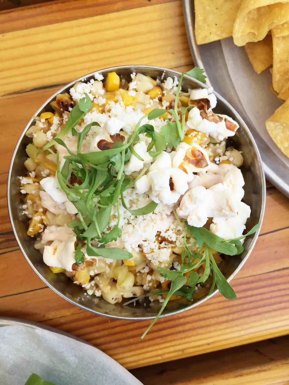 STREET CORN - fresh corn off the cob / spices / chipotle cream / popcorn.