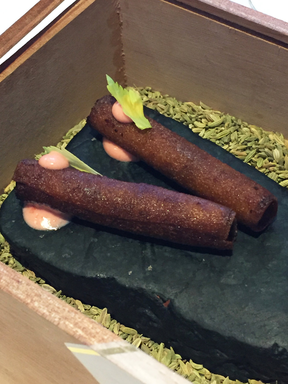 Wagyu beef cigar rolled in pastry with clam mayonaise and celery