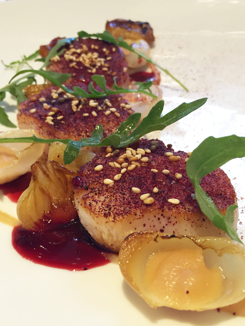 Hokkaido Scallops with cipollini onion, smoked apple, and hibiscus.