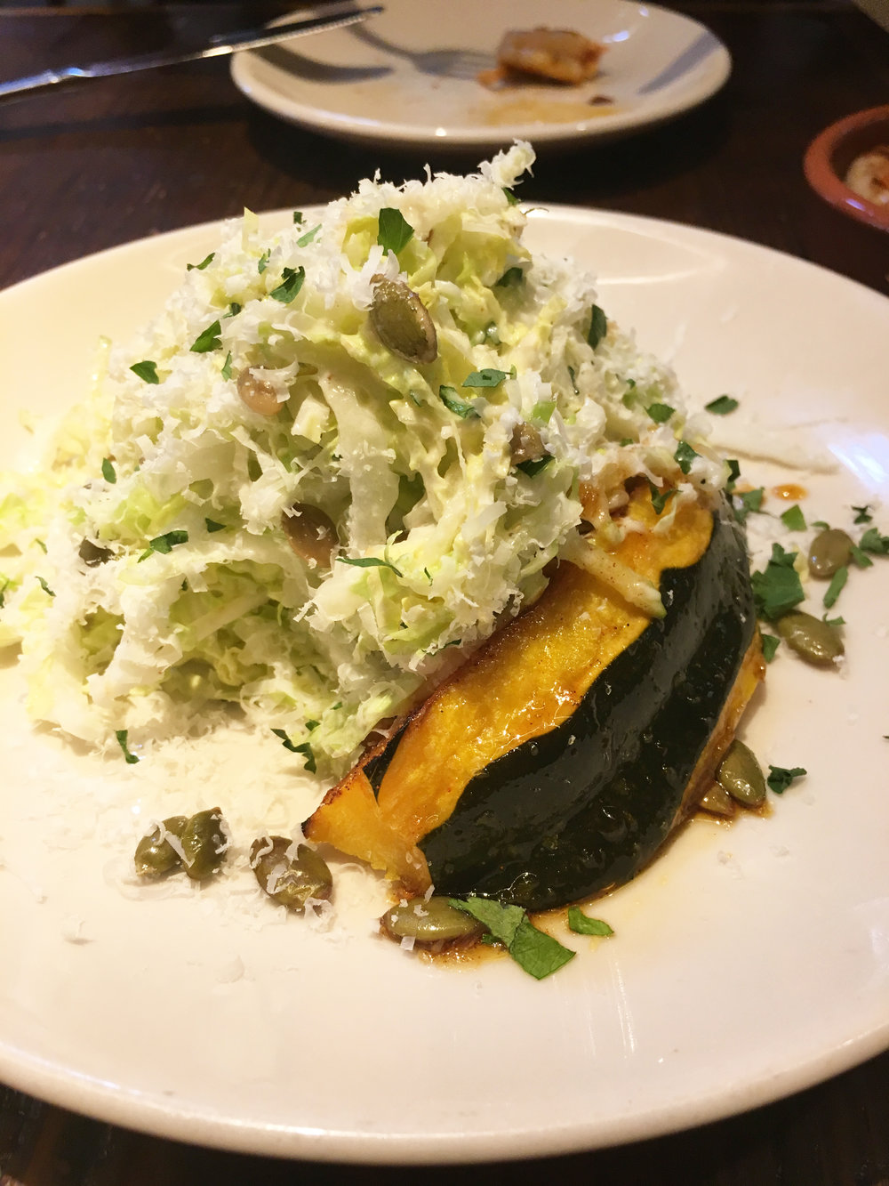 Napa cabbage + apple slaw with creamy shallot-lime vinaigrette, roasted acorn squash, pepitas