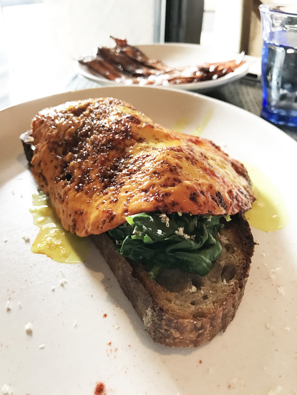 Golden Eggs - lodge toast, avocado, spinach, horseradish, turmeric, coconut oil