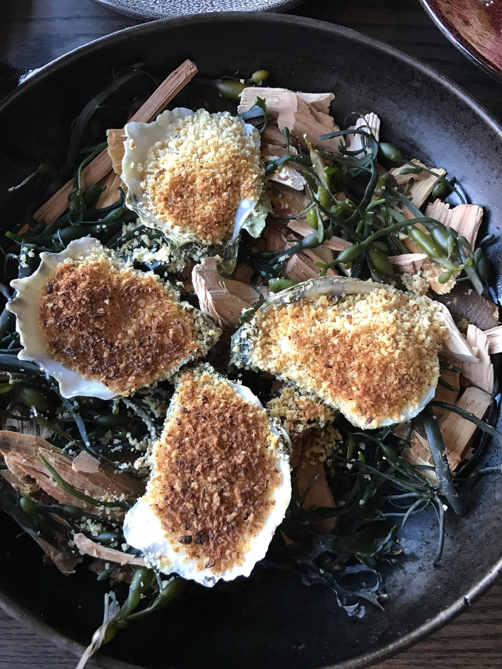 Smoked oysters with garlic butter and breadcrumbs.