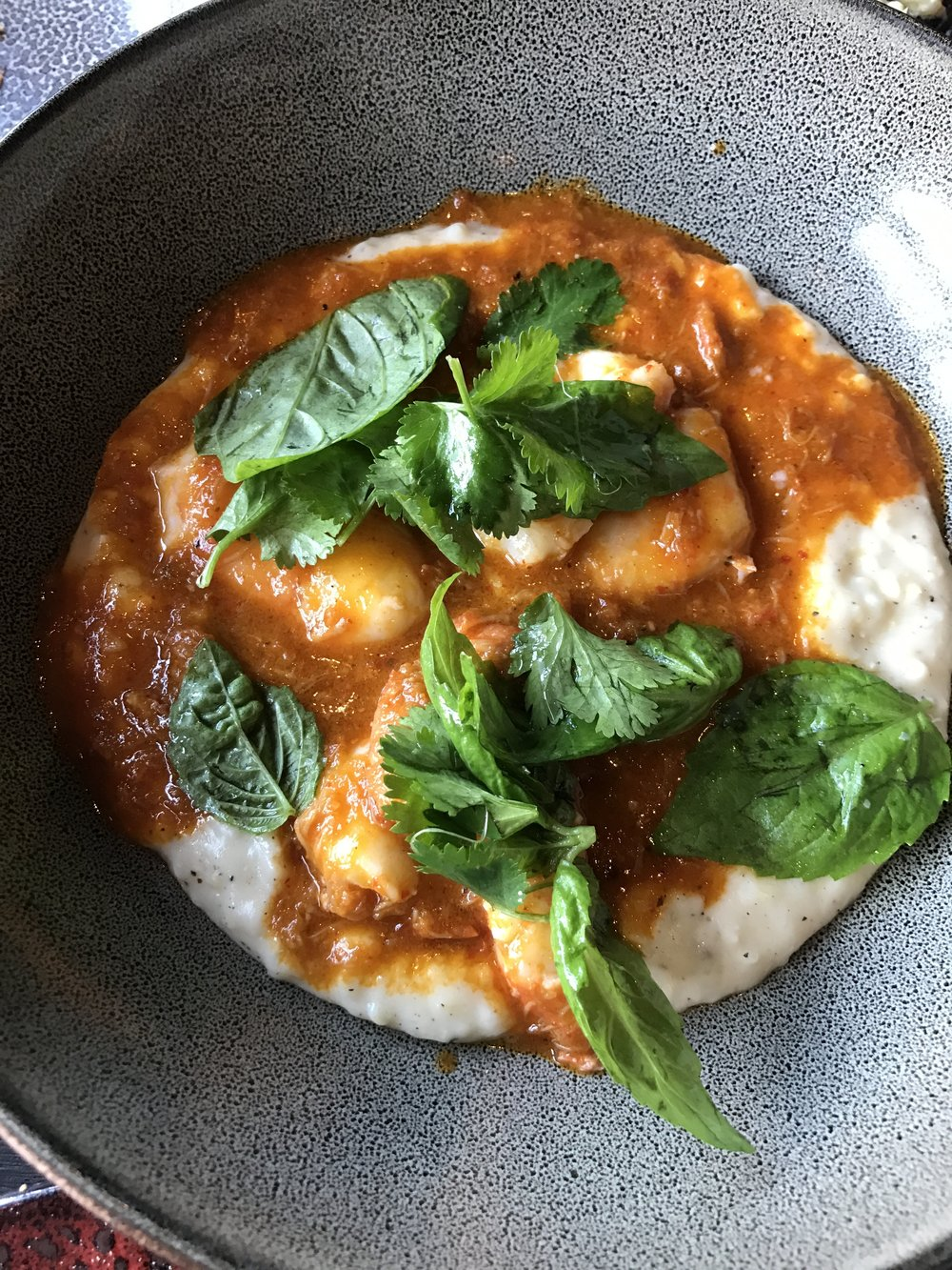 Anson Mills grits with Key West pink shrimp, crab curry, and Thai basil.