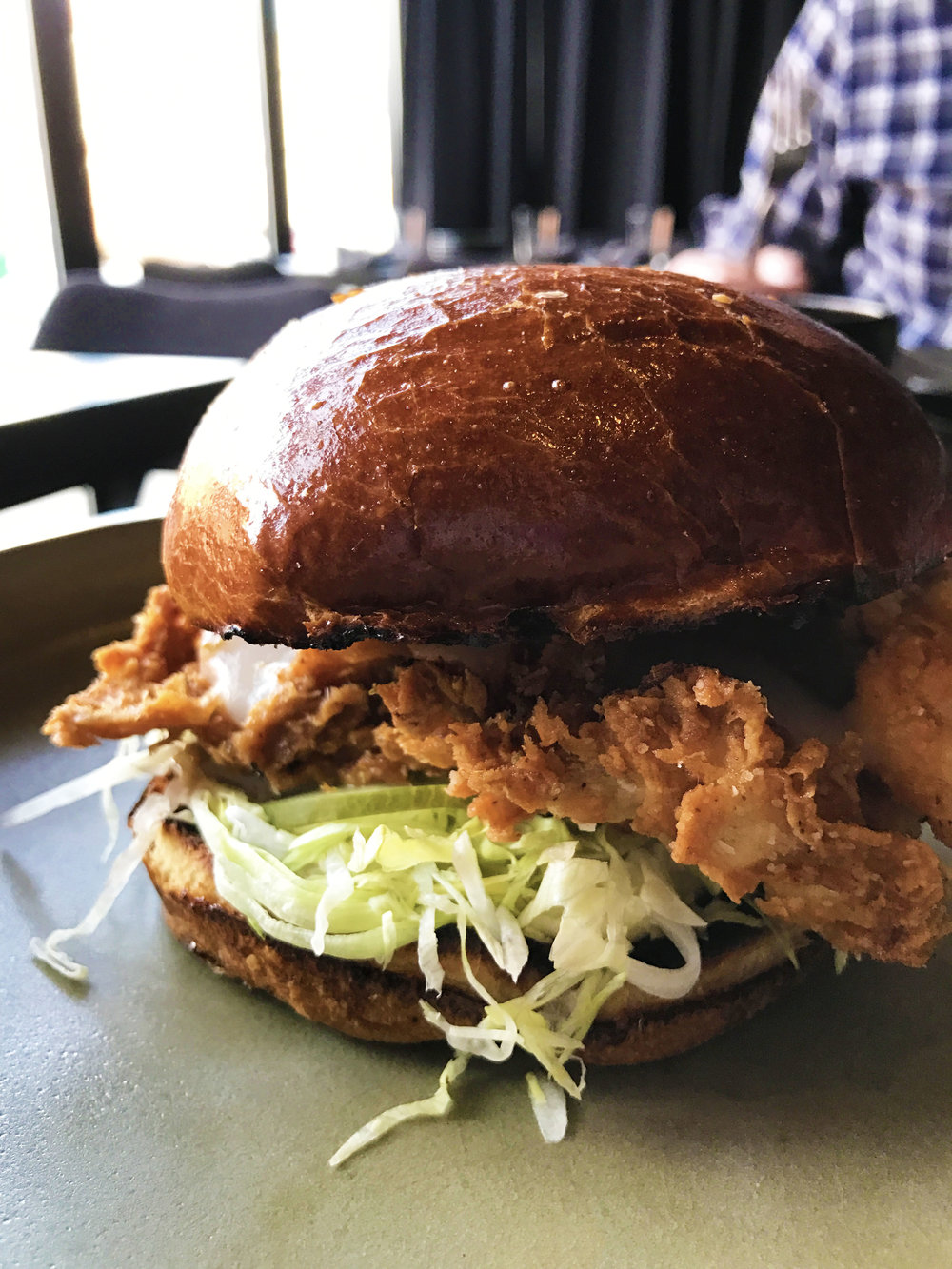 Fried Chicken Sandwich with sunchoke hot sauce and chamomile mayo.