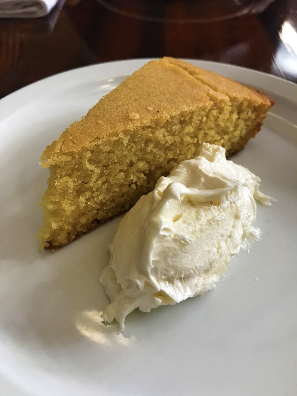 Warm homemade corn bread with whipped honey butter