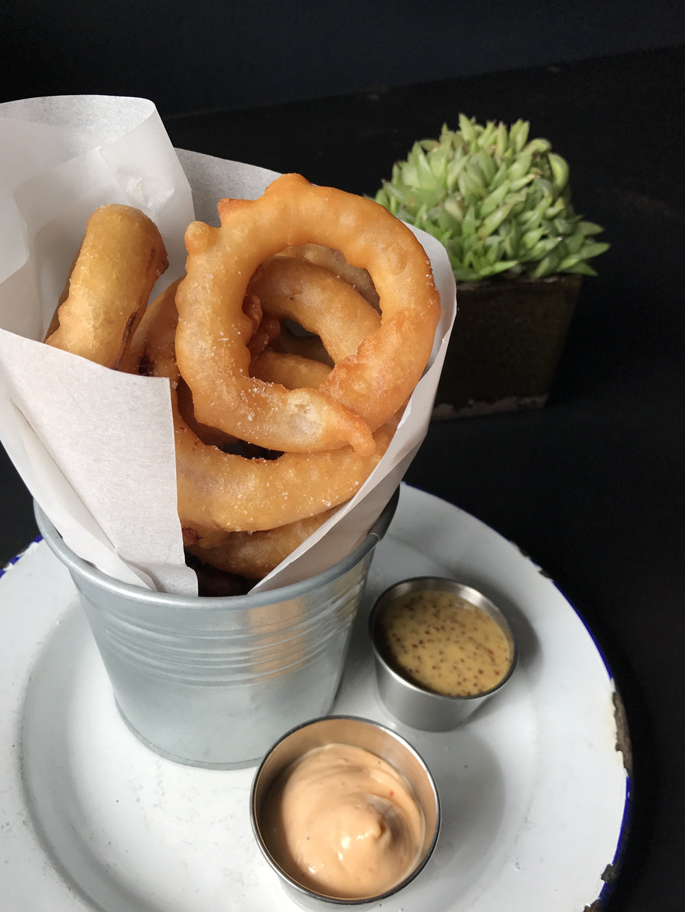 Balsamic marinated onion rings with spiced aioli and mustard