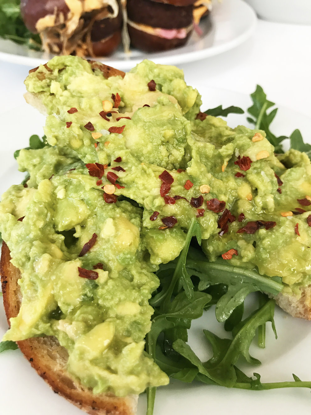 Avocado Toast  with red chili flakes, lemon, olive oil, and maldon