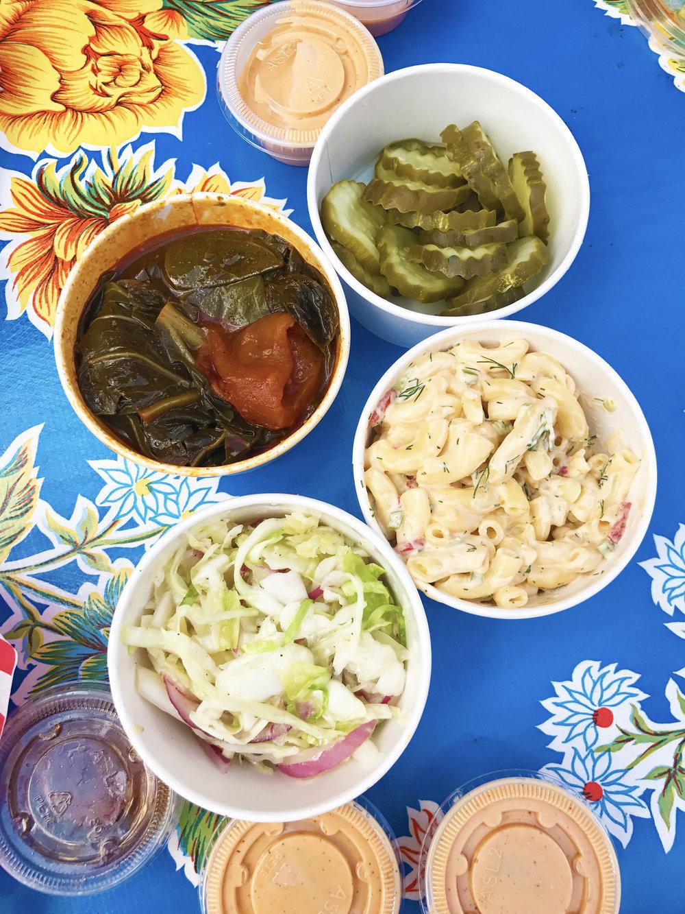 Pickles, Macaroni Salad, Slaw, Collards, and tons of Comeback Sauce