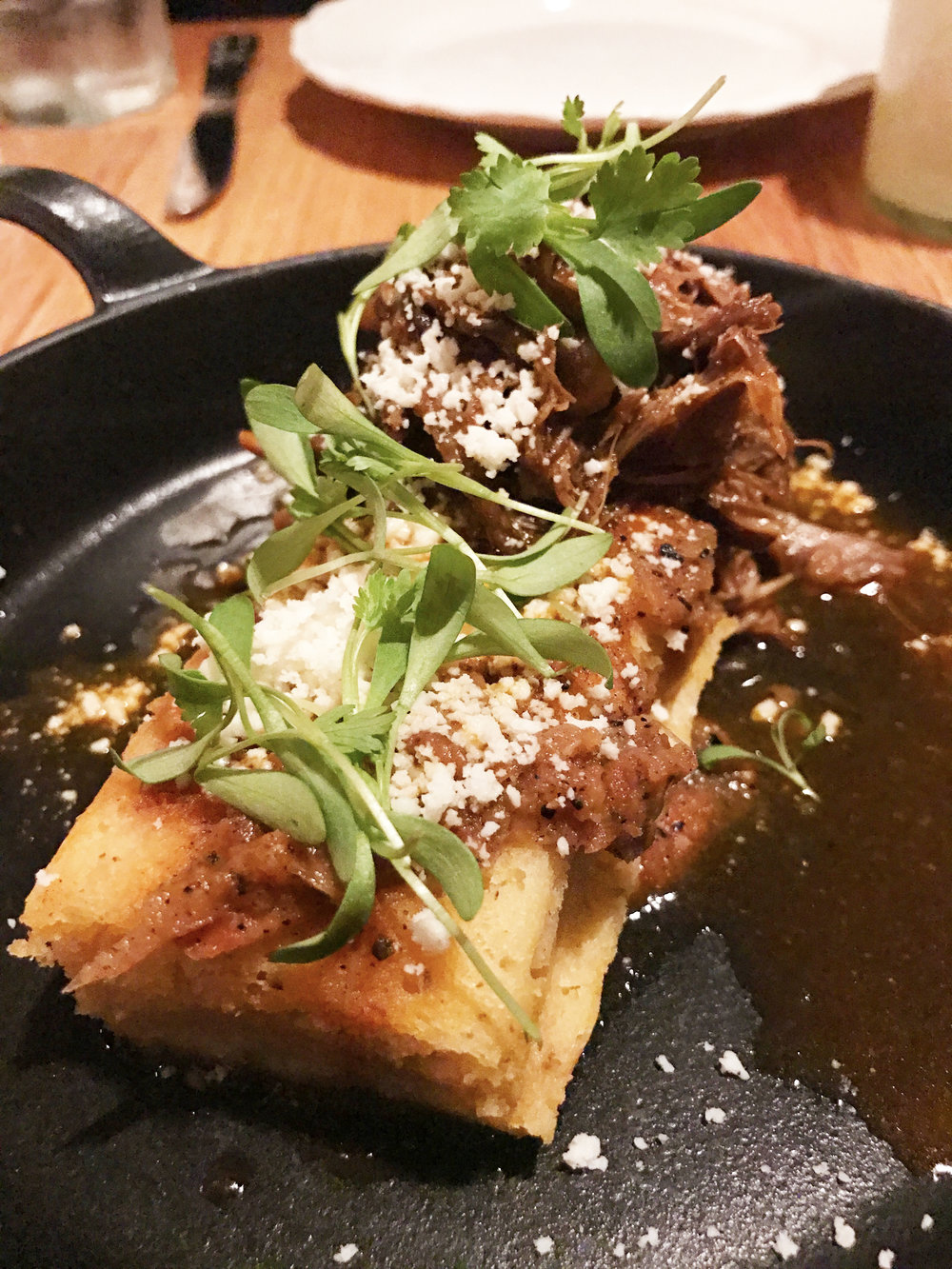 Tamale with lamb neck, king oyster mushrooms, and queso oaxaca