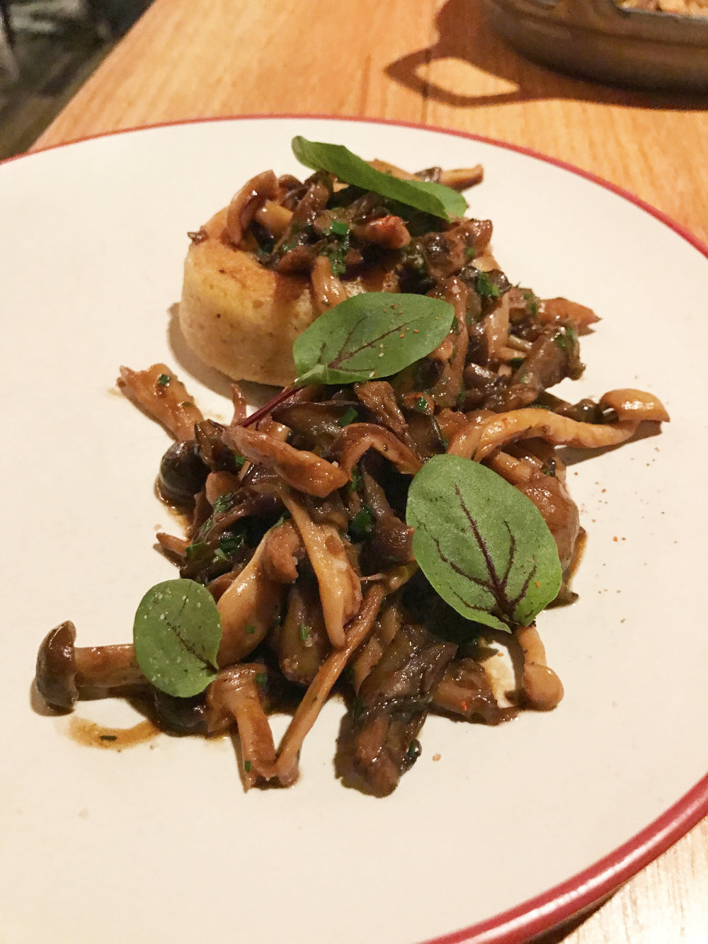 Mushrooms with black garlic, chile de arbol, verdolaga, and griddled masa