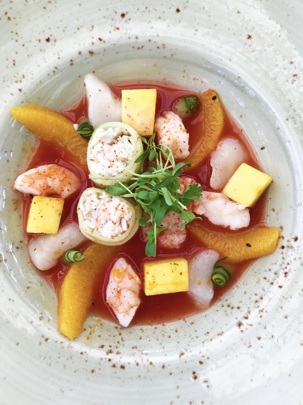 Catch Ceviche with king crab, lobster, shrimp, scallop, mango, blood orange, and ponzu
