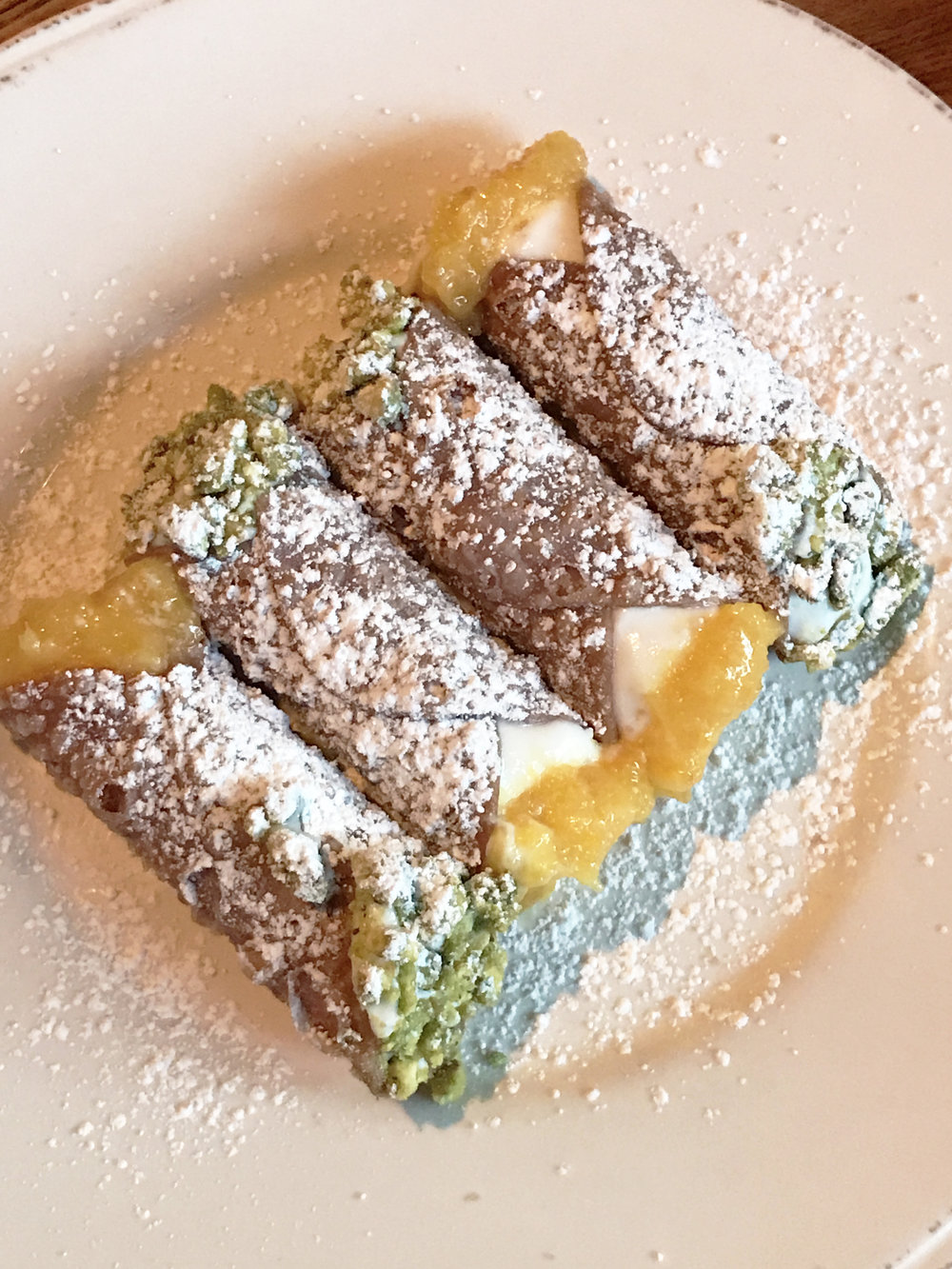 Cannoli - homemade cannoli shells, ricotta filling, orange marmalade, pistachios