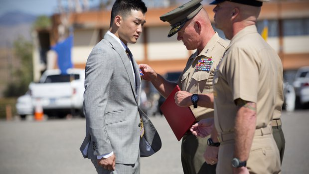 During a ceremony at 5th Marines in Camp Pendleton, Jonathan Kong is awarded the Silver Star from Maj. Gen. Lawrence Nicholson. Kong was a Hospital Corpsman Second Class while serving in the U.S. Navy and assigned to 1st Battalion, 5th Marines when he was deployed to Sangin, Afghanistan. — Nelvin C. Cepeda / UT San Diego/Twitter @NelCepeda