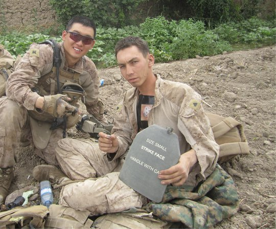 HM3 Jonathan Kong and Cpl. Michael Dawers in Sangin, Afghanistan in 2011. (USMC released.)